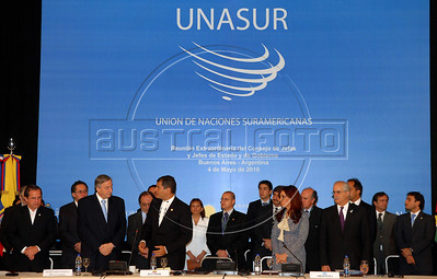 Former Argentine President Nestor Kirchner, left,  Ecuador's President Rafael Correa, center, Argentina's President Cristina Fernandez de Kirchner, right, and Foreign Ministers, after Kirchner took the oath as the secretary-general of the Union of South American Nations Union (UNASUR) in Campana, 70 km north of Buenos Aires, Argentina, May 4, 2010. (Austral Foto/Horacio Paone)