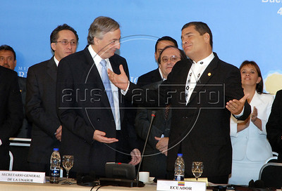 Former Argentine President Nestor Kirchner, left, is congratulated by Ecuador's President Rafael Correa, right, after Kirchner took the oath as the secretary-general of the Union of South American Nations Union (UNASUR) in Campana, 70 km north of Buenos Aires, Argentina, May 4, 2010. (Austral Foto/Horacio Paone)