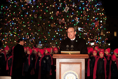The Architect of the Capitol, Stephen Ayers, emceed the 2010 Capitol Christmas Tree lighting ceremony. In one of her last official roles as Speaker of the House, Nancy Pelosi (D-CA) lit the tree during a 5 PM ceremony on the West Front lawn on December 7, 2010 in Washington DC.  The 67-foot Engelmann spruce came from Wyoming's Bridger-Teton National Forest and was decorated with thousands of ornaments made by Wyoming residents. (Photo by Jeff Malet)