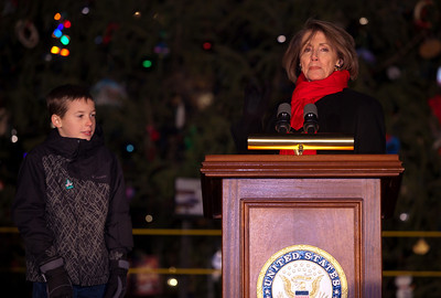 In one of her last official roles as Speaker of the House, Nancy Pelosi (D-CA) lights the US Capitol's Christmas tree during a 5 PM ceremony on the West Front lawn on December 7, 2010 in Washington DC.  Helping Speaker Pelosi light the tree, Fairview Wyoming sixth-grader Daniel Sitter (on the left). Sitter's name was drawn from more than 1,000 Wyoming students who provided an ornament for the U.S. Capitol Christmas Tree. The 67-foot Engelmann spruce came from Wyoming's Bridger-Teton National Forest and was decorated with thousands of ornaments made by Wyoming residents. (Photo by Jeff Malet)