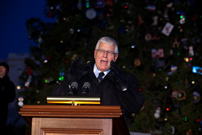 Wyoming Senator Mike Enzi (R) speaks during the 2010 Capitol Christmas Tree lighting ceremony. In one of her last official roles as Speaker of the House, Nancy Pelosi (D-CA) lit the tree during a 5 PM ceremony on the West Front lawn on December 7, 2010 in Washington DC.  The 67-foot Engelmann spruce came from Wyoming's Bridger-Teton National Forest and was decorated with thousands of ornaments made by Wyoming residents. (Photo by Jeff Malet)