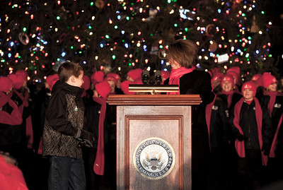 In one of her last official roles as Speaker of the House, Nancy Pelosi (D-CA) lights the US Capitol's Christmas tree during a 5 PM ceremony on the West Front lawn on December 7, 2010 in Washington DC.  Helping Speaker Pelosi light the tree, Fairview Wyoming sixth-grader Daniel Sitter (on the left). Sitter's name was drawn from more than 1,000 Wyoming students who provided an ornament for the U.S. Capitol Christmas Tree. Members of the Cheyenne All City Children's Choir entertained with a medley of carols.  The 67-foot Engelmann spruce came from Wyoming's Bridger-Teton National Forest and was decorated with thousands of ornaments made by Wyoming residents. (Photo by Jeff Malet)