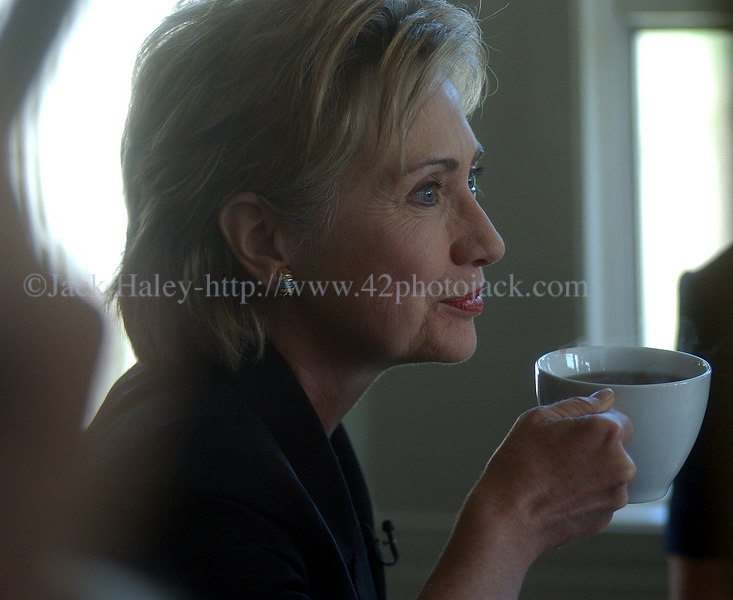 DSC_1090 - U.S. Senator Hillary Clinton enjoys a cup of coffee during  her visit  in Palmyra, NY in August. (Photo by Jack Haley)