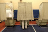 A voter cast his ballot in a voting booth during the North Carolina primaries at a polling station at a school in Hendersonville, NC, July 20, 2004.(Australfoto/Douglas Engle)
