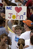 A boy holds a sign in support of US Presidential candidate John Kerry and Vice-Presidential candidate John Edwards at a rally at NC State University in Raleigh, NC, Saturday, July 10, 2004.(Australfoto/Douglas Engle)