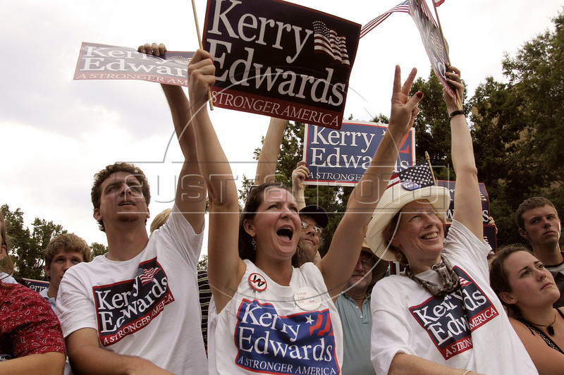Supporters cheer for US Presidential candidate John Kerry and Vice-Presidential candidate John Edwards at a rally at NC State University in Raleigh, NC, Saturday, July 10, 2004.(Australfoto/Douglas Engle)