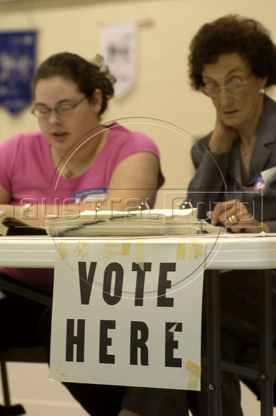 Poll workers wait for voters at a reception table during the North Carolina primaries at a polling station at a school in Hendersonville, NC, July 20, 2004.(Australfoto/Douglas Engle)