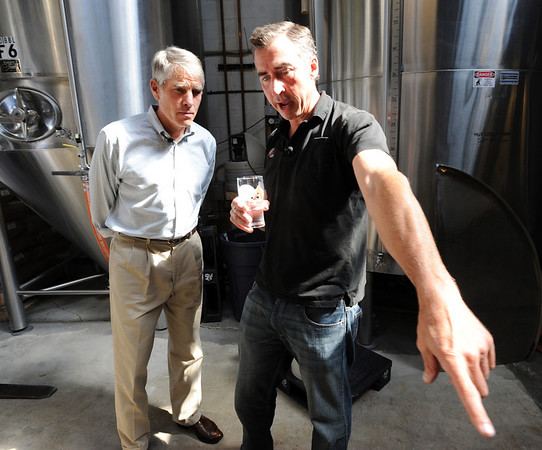 "Co-owner of Avery Brewery, Adam Avery, right, talks about the brewing process with Senator Mark Udall on Friday.<br /> Colorado Senator, Mark Udall, toured Avery Brewery in Boulder  to bring attention to Colorado's  growing craft brewing industry.<br /> For more photos and a video of Udall at Avery, go to  <a href=""http://www.dailycamera.com"">http://www.dailycamera.com</a><br /> Cliff Grassmick / July 13, 2012"