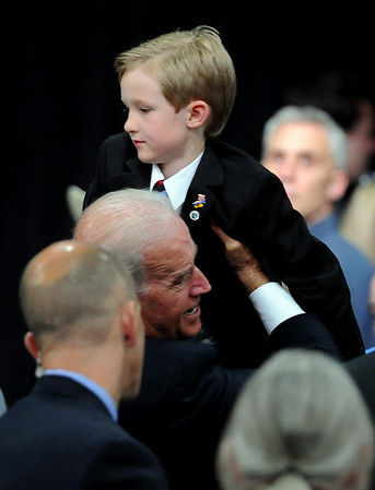 "Joe Biden lifts up a boy to be photographed with him while greeting the crowd.<br /> Joe Biden, Vice President of the United States, visited UQM Technologies, outside Longmont, to talk about how the Recovery Act is transforming the American economy through investments in innovation and technology.<br /> For more photos  and a video of the visit, go to  <a href=""http://www.dailycamera.com"">http://www.dailycamera.com</a><br /> Cliff Grassmick / April 30, 2010"