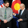 "Joe Biden, right, gives  Duane Bartley, a new employee at UQM Technologies, a playful punch before Bartley tells his recovery story.<br /> Joe Biden, Vice President of the United States, visited UQM Technologies, outside Longmont, to talk about how the Recovery Act is transforming the American economy through investments in innovation and technology.<br /> For more photos  and a video of the visit, go to  <a href=""http://www.dailycamera.com"">http://www.dailycamera.com</a><br /> Cliff Grassmick / April 30, 2010"