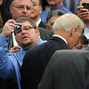 "A man in the crowd attempts to get a photo of the Vice President.<br /> Joe Biden, Vice President of the United States, visited UQM Technologies, outside Longmont, to talk about how the Recovery Act is transforming the American economy through investments in innovation and technology.<br /> For more photos  and a video of the visit, go to  <a href=""http://www.dailycamera.com"">http://www.dailycamera.com</a><br /> Cliff Grassmick / April 30, 2010"
