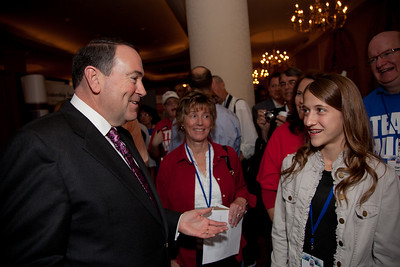 Presidential hopeful Mike Hackabee greets young Cassidy Bowers from Boise Idaho at the Values Voter Summit in Washington DC on September 17, 2010.  The event was sponsored by the Family Research Council.  (Photo by Jeff Malet).