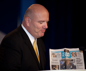 From the podium, master of ceremonies Gil Mertz of the Family Research Council (FRC) shows off front page of the USA Today article about the just completed Delaware Senate Primary won by tea party supported candidate Christine O'Donnell, to thunderous applause as Social conservatives gathered at the Values Voter Summit in Washington DC on September 17, 2010. The event was sponsored by the Family Research Council. (Photo by Jeff Malet).