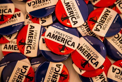 "Social Conservatives ""Pray for America"" at the Values Voter Summit on Friday, Sept 15, 2012 in Washington DC. ""Pray for America"" buttons are for the taking at the annual gathering of Christian conservatives and elected officials The Values Voter Summit is a joint production of the Family Research Council and other social conservative groups. Gay marriage, abortion, religion and the upcoming presidential election dominated the discussion. (Photo by Jeff Malet)"