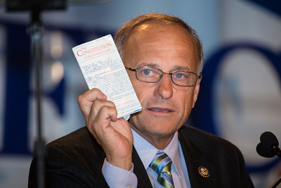 Holding up a copy of the US Constitution, Representative Steve King (R-Iowa) speaks at the Values Voter Summit on Friday, Sept 14, 2012 in Washington DC. The annual gathering of Christian conservatives and elected officials is a joint production of the Family Research Council and other social conservative groups. Gay marriage, abortion, religion and the upcoming presidential election dominated the discussion. (Photo by Jeff Malet)