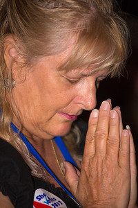Attendee Ellen Staniszewski of Bowie MD prays during the invocation at the Values Voter Summit on Friday, Sept 14, 2012 in Washington DC. The annual gathering of Christian conservatives and elected officials is a joint production of the Family Research Council and other social conservative groups. Gay marriage, abortion, religion and the upcoming presidential election dominated the discussion. (Photo by Jeff Malet)