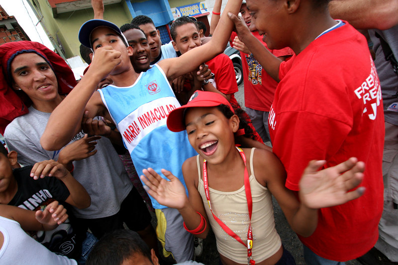 Supporters of Venezuelan President Hugo Chavez cheer his apparent election victory in a poor neighborhood of Caracas, Venezuela, Dec. 3 , 2006. Early results show Chavez with about 60 percent of the vote over his main rival Manuel Rosales.  Chavez is a master of marketing and has achieved pop star status among the lower classes, who adore him.(AustralFoto/Douglas Engle)