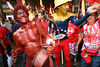 Supporters of Venezuelan President Hugo Chavez, dressed up as the devil, left, and the Venezuelan flag cheer his election victory in a poor neighborhood of Caracas, Venezuela, Dec. 4 , 2006. Early results show Chavez with about 60 percent of the vote over his main rival Manuel Rosales.  Chavez is a master of marketing and has achieved pop star status among the lower classes, who adore him. Venezuela called George Bush the Devil at the UN earlier this year.(AustralFoto/Douglas Engle)