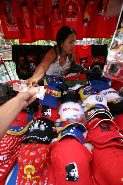Vendors sell items in support of Venezuelan President Hugo Chavez in Caracas, Venezuela, Nov. 30, 2006. Chavez, first elected President in 1998 leads some opinion polls for the Dec. 3 2006 election with up to 60 percent of voter intentions. Chavez is a master of marketing and has achieved pop star status among the lower classes, who adore him.(AustralFoto/Douglas Engle)