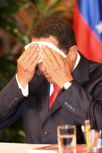 Venezuelan President Hugo Chavez, wipes his brow before a press conference in Caracas, Venezuela, Nov. 30, 2006. Chavez, first elected President in 1998 leads some opinion polls for the Dec. 3 2006 election with up to 60 percent of voter intentions. Chavez is a master of marketing and has achieved pop star status among the lower classes, who adore him.(AustralFoto/Douglas Engle)