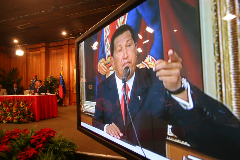 Venezuelan President Hugo Chavez is seen on a television monitor during a press conference in Caracas, Venezuela, Nov. 30, 2006. Chavez, first elected President in 1998 leads some opinion polls for the Dec. 3 2006 election with up to 60 percent of voter intentions. Chavez is a master of marketing and has achieved pop star status among the lower classes, who adore him.(AustralFoto/Douglas Engle)