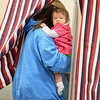 Nine month old Amalia Couto checks things out as her mom votes in Pepperell at Varnum Brook Elementary School on Monday. SENTINEL & ENTERPRISE/JOHN LOVE