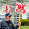 Don Klein, candidate for selectman hold his sign out in front of the polls at Town Hall in Townsend on Monday morning. SENTINEL & ENTERPRISE/JOHN LOVE