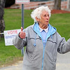 Lillian Whitney gives the thumbs up as she greeted voters at the polls in Ashby on Monday. SENTINEL & ENTERPRISE/JOHN LOVE