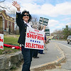 Laura Shifrin, candidate for selectman, waves to cars passing by Town Hall in Townsend on Monday. SENTINEL & ENTERPRISE/JOHN LOVE