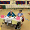 Waiting for voters in Ashburnham is election officials Louise Reid and Betty Bushee.  SENTINEL& ENTERPRISE/JOHN LOVE   SENTINEL& ENTERPRISE/JOHN LOVE