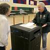 Election official Sallie Thoma mans the ballot box as Joan Webber cast her ballot at the polls in Ashburnham on Tuesday. SENTINEL& ENTERPRISE/JOHN LOVE