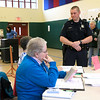 Chatting with election officials at the polls on Tuesday in Ashburnham is Officer Jason Bourjeois who was on duty at the polls. SENTINEL& ENTERPRISE/JOHN LOVE