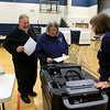 Heather and Gary Richards cast their ballots as election official Barbara Parsons makes sure nothing goes wrong at the polls in Westminster on Tuesday. SENTINEL& ENTERPRISE/JOHN LOVE