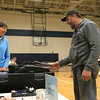 Election official Karen Brighenhti  mans the ballot box in Westminster as Mike Aho cast his ballot at the polls in Westminster on Tuesday. SENTINEL& ENTERPRISE/JOHN LOVE
