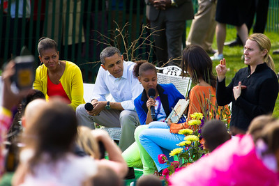 "Barack and Michelle Obama join daughters Sasha and Malia in reading books to kids. In photo, Malia and Sasha take turns reading from ""A Sick Day for Amos McGee"" by Philip C. Stead.  The 134th annual White House Egg Roll attracted over 30,000 visitors to the White House South Lawn for a day of racing, reading and fun on Monday, April 9, 2012. The theme of this year's egg roll was ""Let's Go, Let's Play, Let's Move!"" which was modeled after the First Lady's ""Let's Move!"" campaign.  (Photo by Jeff Malet)"