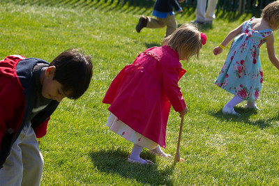 "Kids using wooden spoons move colored hard-boiled eggs down the White House South Lawn to the finish line. The 134th annual White House Egg Roll attracted over 30,000 visitors to the South Lawn for a day of racing, reading and fun on Monday, April 9, 2012. The theme of this year's egg roll was ""Let's Go, Let's Play, Let's Move!"" which was modeled after the First Lady's ""Let's Move!"" campaign.  (Photo by Jeff Malet)"