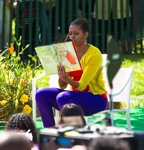 "First Lady Michelle Obama reads ""The Little Mouse, The Red Ripe Strawberry, and The Big Hungry Bear, written by by Don Wood and Audrey Wood. The 134th annual White House Egg Roll attracted over 30,000 visitors to the White House South Lawn for a day of racing, reading and fun on Monday, April 9, 2012. The theme of this year's egg roll was ""Let's Go, Let's Play, Let's Move!"" which was modeled after the First Lady's ""Let's Move!"" campaign.  (Photo by Jeff Malet)"