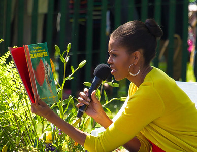 "First Lady Michelle Obama reads ""The Little Mouse, The Red Ripe Strawberry, and The Big Hungry Bear"", written by by Don Wood and Audrey Wood. The 134th annual White House Egg Roll attracted over 30,000 visitors to the White House South Lawn for a day of racing, reading and fun on Monday, April 9, 2012. The theme of this year's egg roll was ""Let's Go, Let's Play, Let's Move!"" which was modeled after the First Lady's ""Let's Move!"" campaign.  (Photo by Jeff Malet)"