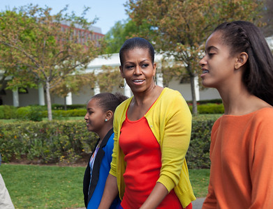 "Sasha, Michelle and Malia Obama walk to the book reading area on the South Lawn. The 134th annual White House Egg Roll attracted over 30,000 visitors to the White House South Lawn for a day of racing, reading and fun on Monday, April 9, 2012. The theme of this year's egg roll was ""Let's Go, Let's Play, Let's Move!"" which was modeled after the First Lady's ""Let's Move!"" campaign.  (Photo by Jeff Malet)"