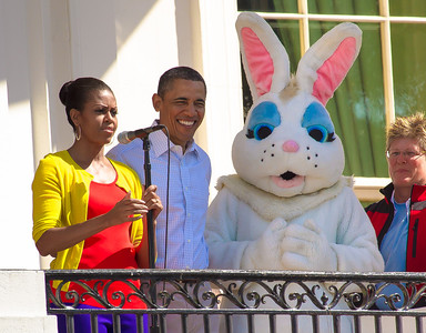 "President Barack Obama and Michelle Obama appear on the White House balcony with the Easter Bunny. The 134th annual White House Egg Roll attracted over 30,000 visitors to the White House South Lawn for a day of racing, reading and fun on Monday, April 9, 2012. The theme of this year's egg roll was ""Let's Go, Let's Play, Let's Move!"" which was modeled after the First Lady's ""Let's Move!"" campaign.  (Photo by Jeff Malet)"
