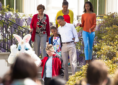"President Barack Obama and the First Family descend the White House steps with the Easter Bunny onto the South Lawn. Left to right, top to bottom in photo, Marian Robinson (Michelle's mother), Michelle, Malia, Sasha and Barack Obama. The 134th annual White House Egg Roll attracted over 30,000 visitors to the White House South Lawn for a day of racing, reading and fun on Monday, April 9, 2012. The theme of this year's egg roll was ""Let's Go, Let's Play, Let's Move!"" which was modeled after the First Lady's ""Let's Move!"" campaign.  (Photo by Jeff Malet)"