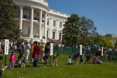 "Barack Obama walks to the book reading area on the South Lawn. The 134th annual White House Egg Roll attracted over 30,000 visitors to the White House South Lawn for a day of racing, reading and fun on Monday, April 9, 2012. The theme of this year's egg roll was ""Let's Go, Let's Play, Let's Move!"" which was modeled after the First Lady's ""Let's Move!"" campaign.  (Photo by Jeff Malet)"