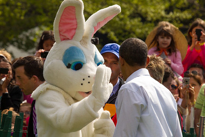 "President Barack Obama high fives the Easter Bunny. The 134th annual White House Egg Roll attracted over 30,000 visitors to the White House South Lawn for a day of racing, reading and fun on Monday, April 9, 2012. The theme of this year's egg roll was ""Let's Go, Let's Play, Let's Move!"" which was modeled after the First Lady's ""Let's Move!"" campaign.  (Photo by Jeff Malet)"