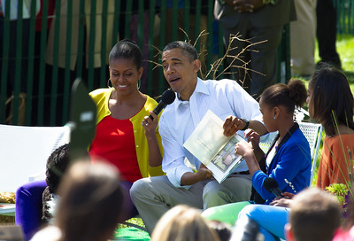 "Barack and Michelle Obama join daughters Sasha and Malia in reading books to kids. In photo, President Obama reads from Maurice Sendak's ""Where the Wild Things Are."" The 134th annual White House Egg Roll attracted over 30,000 visitors to the White House South Lawn for a day of racing, reading and fun on Monday, April 9, 2012. The theme of this year's egg roll was ""Let's Go, Let's Play, Let's Move!"" which was modeled after the First Lady's ""Let's Move!"" campaign.  (Photo by Jeff Malet)"