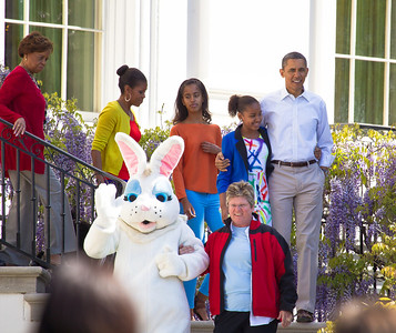 "President Barack Obama and the First Family descend the White House steps with the Easter Bunny onto the South Lawn. Left to right in photo, Marian Robinson (Michelle's mother), Michelle, Malia, Sasha and Barack Obama. The 134th annual White House Egg Roll attracted over 30,000 visitors to the White House South Lawn for a day of racing, reading and fun on Monday, April 9, 2012. The theme of this year's egg roll was ""Let's Go, Let's Play, Let's Move!"" which was modeled after the First Lady's ""Let's Move!"" campaign.  (Photo by Jeff Malet)"