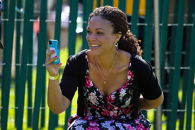 "Malissa Harris-Perry of MSNBC snaps photos of her daughter. The 134th annual White House Egg Roll attracted over 30,000 visitors to the White House South Lawn for a day of racing, reading and fun on Monday, April 9, 2012. The theme of this year's egg roll was ""Let's Go, Let's Play, Let's Move!"" which was modeled after the First Lady's ""Let's Move!"" campaign.  (Photo by Jeff Malet)"