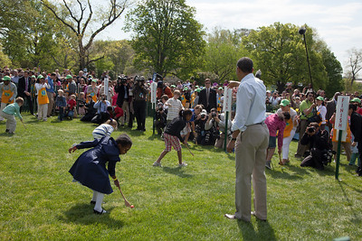 "President Obama starts the egg roll. Kids using wooden spoons move colored hard-boiled eggs down the White House South Lawn to the finish line. The 134th annual White House Egg Roll attracted over 30,000 visitors to the South Lawn for a day of racing, reading and fun on Monday, April 9, 2012. The theme of this year's egg roll was ""Let's Go, Let's Play, Let's Move!"" which was modeled after the First Lady's ""Let's Move!"" campaign.  (Photo by Jeff Malet)"
