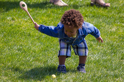 "Porter takes a swing. Kids using wooden spoons move colored hard-boiled eggs down the White House South Lawn to the finish line. The 134th annual White House Egg Roll attracted over 30,000 visitors to the South Lawn for a day of racing, reading and fun on Monday, April 9, 2012. The theme of this year's egg roll was ""Let's Go, Let's Play, Let's Move!"" which was modeled after the First Lady's ""Let's Move!"" campaign.  (Photo by Jeff Malet)"