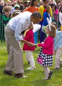 "President Barack Obama greets the kids on the South Lawn for the egg roll. The 134th annual White House Egg Roll attracted over 30,000 visitors to the White House South Lawn for a day of racing, reading and fun on Monday, April 9, 2012. The theme of this year's egg roll was ""Let's Go, Let's Play, Let's Move!"" which was modeled after the First Lady's ""Let's Move!"" campaign.  (Photo by Jeff Malet)"