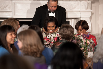 Michelle Obama is seated next to her mother, Marian Robinson (right), at a Mother's Day Tea in the State Dining Room of the White House on May 7, 2010. The event included former first lady Rosalynn Carter and granddaughter, Sarah Carter; President Richard Nixon's daughter Tricia Nixon Cox; and President Dwight D. Eisenhower's granddaughters Susan and Anne Eisenhower, along with young women who participate in Mrs. Obama's mentoring program, spouses and mothers of service members, and Vice President Joe Biden's wife, Jill. (Photo by Jeff Malet)